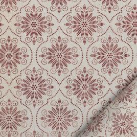 papier pour le cartonnage à motifs stylisés rouges sur fond ivoiree