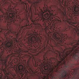 papier pour le cartonnage imprimé de fleurs d'anémones stylisées noires sur fond rouge