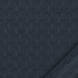 papier pour le cartonnage et la reliure. De couleur bleu foncé uni sur un léger cannage en relief