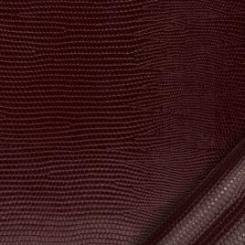papier simili cuir au motif lézard bordeaux dont l'aspect et le toucher sont proches des cuirs exotiques.