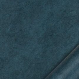 papier indien fait main à partir de la pulpe de coton recyclé issue de l'induxtrie textile. Couleur bleu pétrole