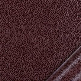 papier simili cuir au motif galuchat marron clair dont l'aspect et le toucher sont proches des cuirs exotiques.
