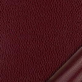 papier simili cuir au motif galuchat rouge dont l'aspect et le toucher sont proches des cuirs exotiques.